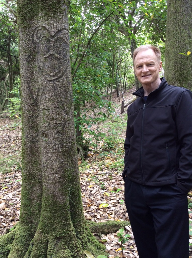 John Bradshaw with Moriori tree carvings hundreds of years old.