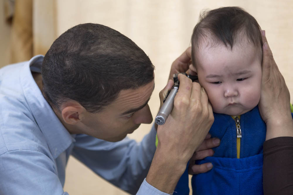 Dr. Dally sees boy complaing of ear aches. (Diagnosis too much ear wax buildup) 378A9777