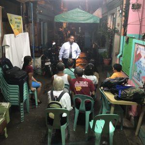 Man preaching in alleyway